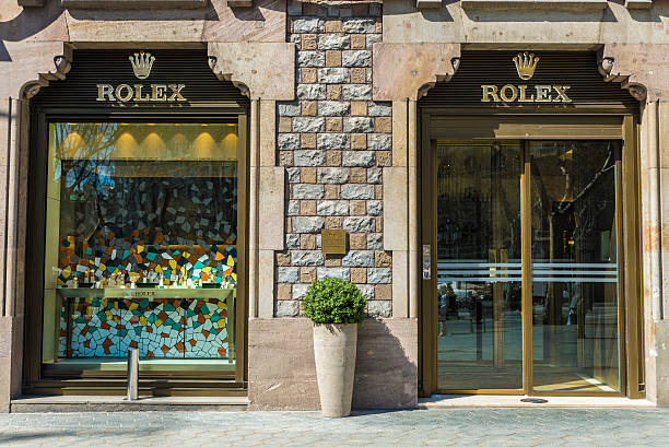 Rolex shop, Barcelona Barcelona, Spain - March 27, 2015: Rolex shop located on Passeig de Gracia, one of the most expensive streets in Europe. gracia baur stock pictures, royalty-free photos & images