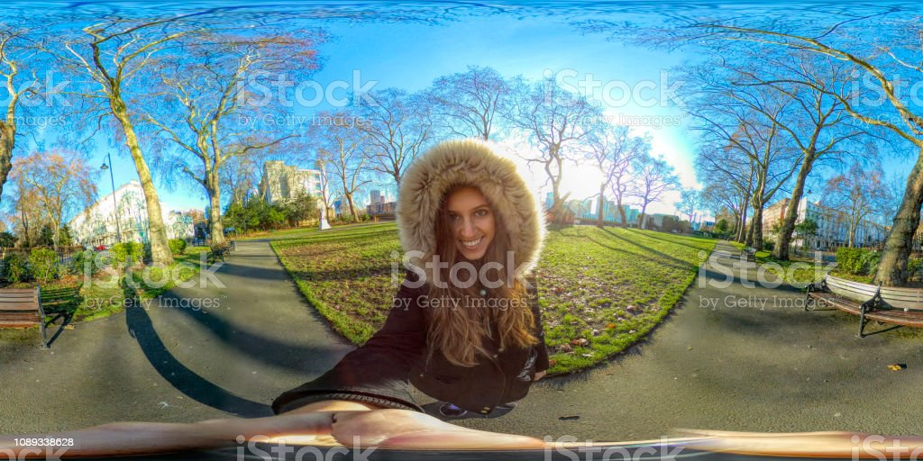 Roll around 360 view of beautiful Russian outdoor girl in London park stock photo
