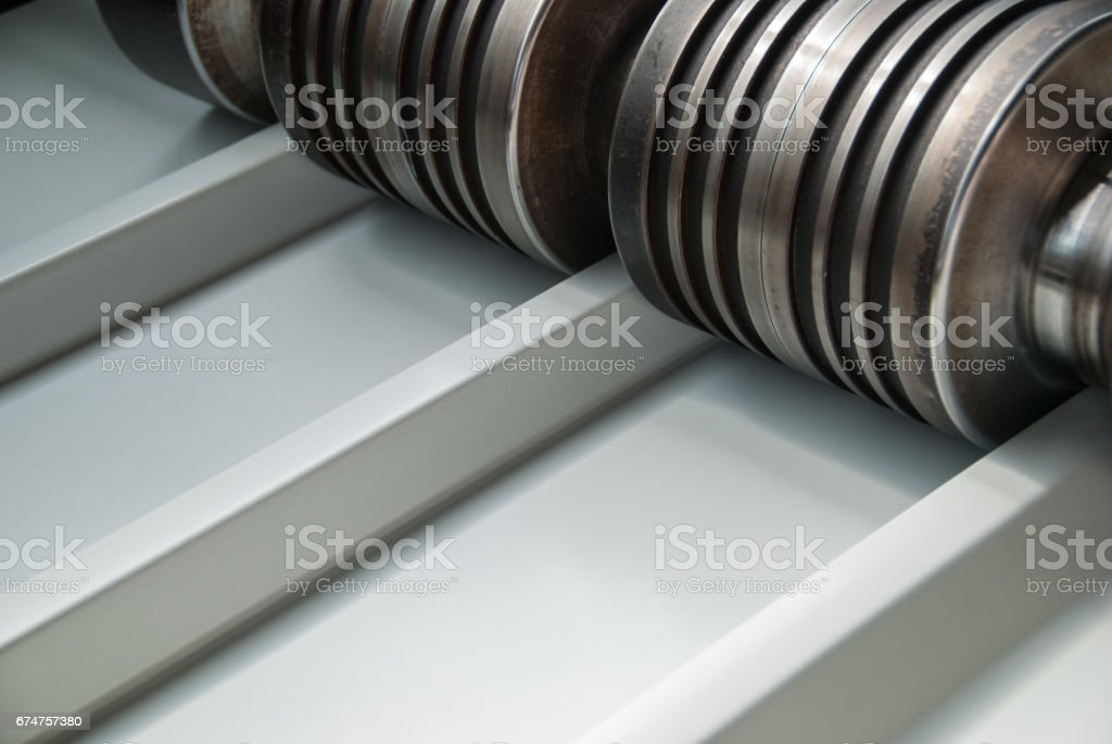 Roll forming line shaping the sheet metal stock photo