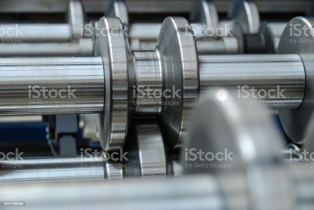Roll forming machine close up stock photo