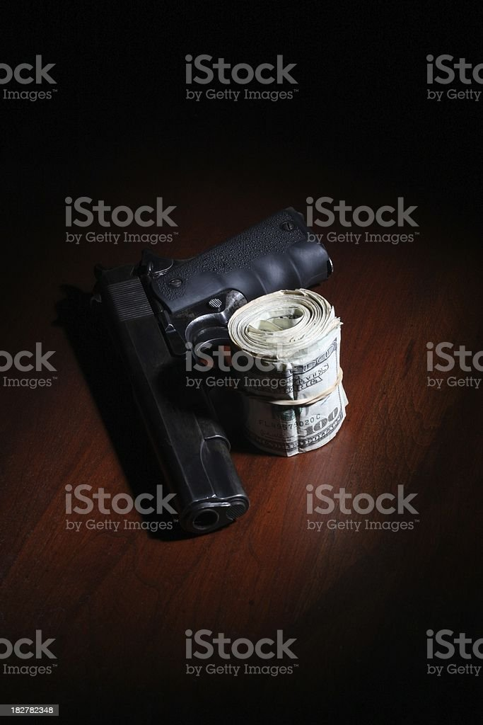 Roll of Cash and a .45 stock photo