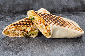 roll of chicken, cucumbers and fries. grilled shawarma