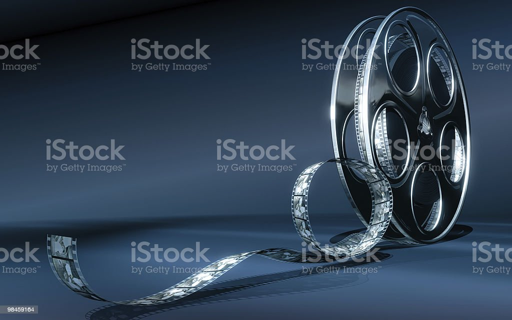 Roll of film isolated on blue background royalty-free stock photo