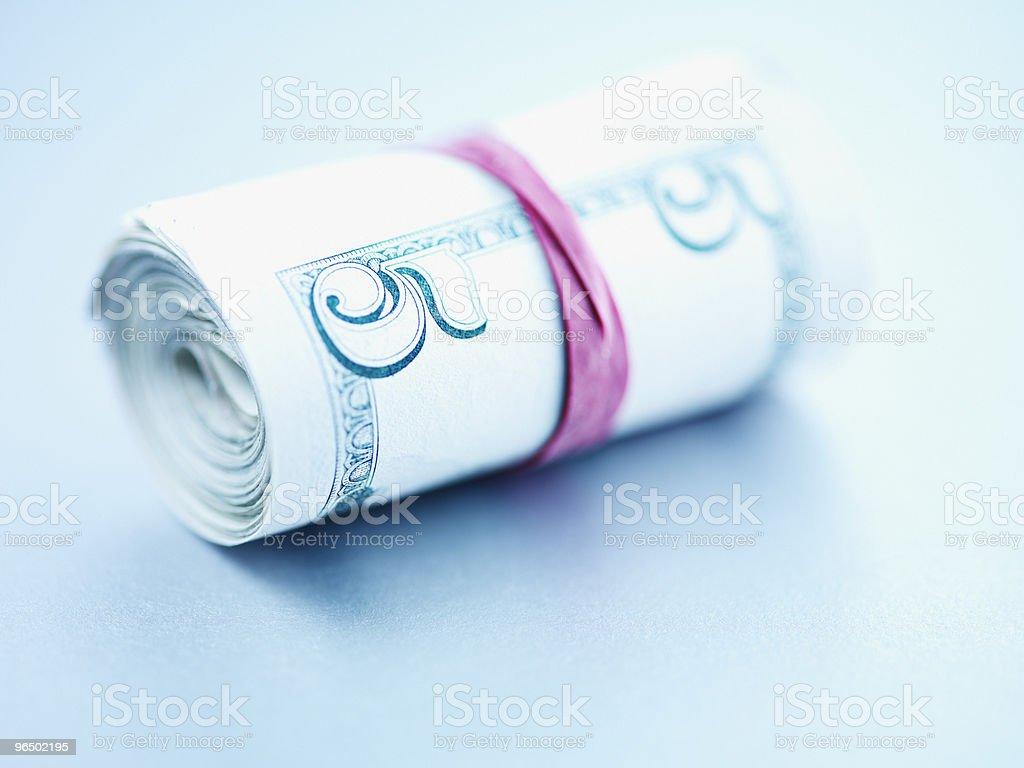 Roll of five dollar bills royalty-free stock photo