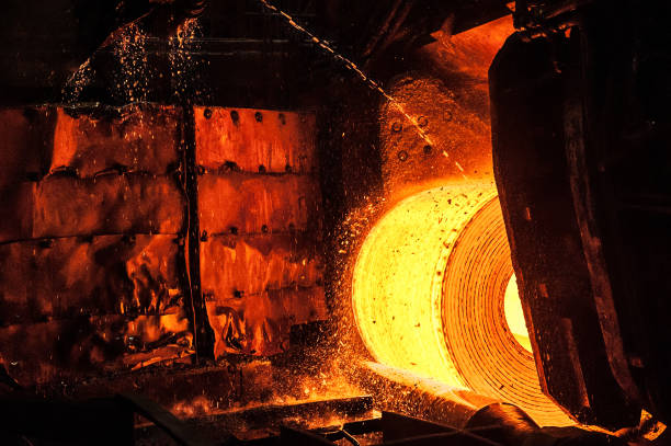 Roll of hot metal on the conveyor belt stock photo