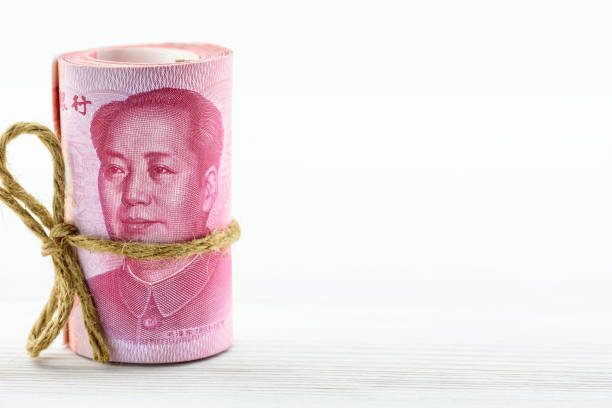 Roll of hundred Chinese yuan bills with a face of Mao zedong Money / currency of PBOC or people's bank of china. mao tse tung stock pictures, royalty-free photos & images