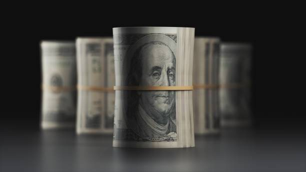 roll of money - money black background stock photos and pictures