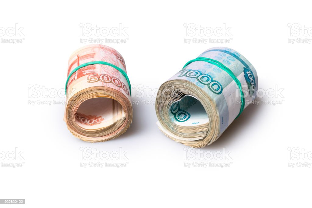 Roll of one thousand and five thousand roubles banknotes stock photo