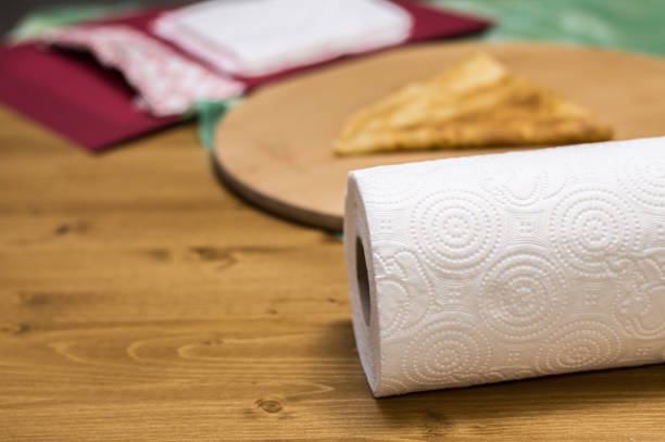 Roll of paper towel on a wooden table stock photo