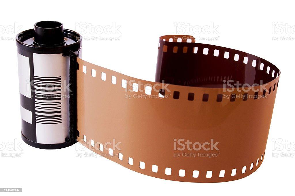 Roll of photosensitive film on white background stock photo