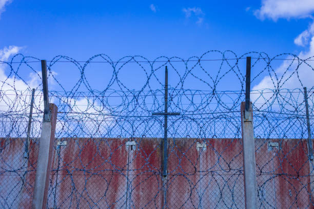 Royalty Free Prison Wall Barbed Wire Fence With Blue Sky Background ...