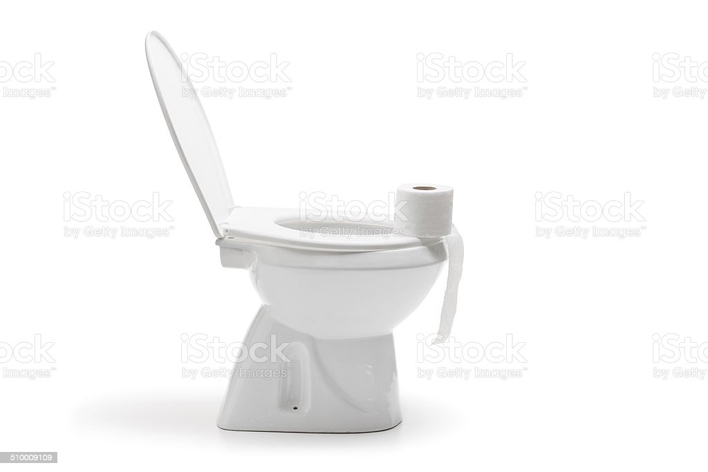 Roll of toilet paper on a ceramic bathroom bowl stock photo