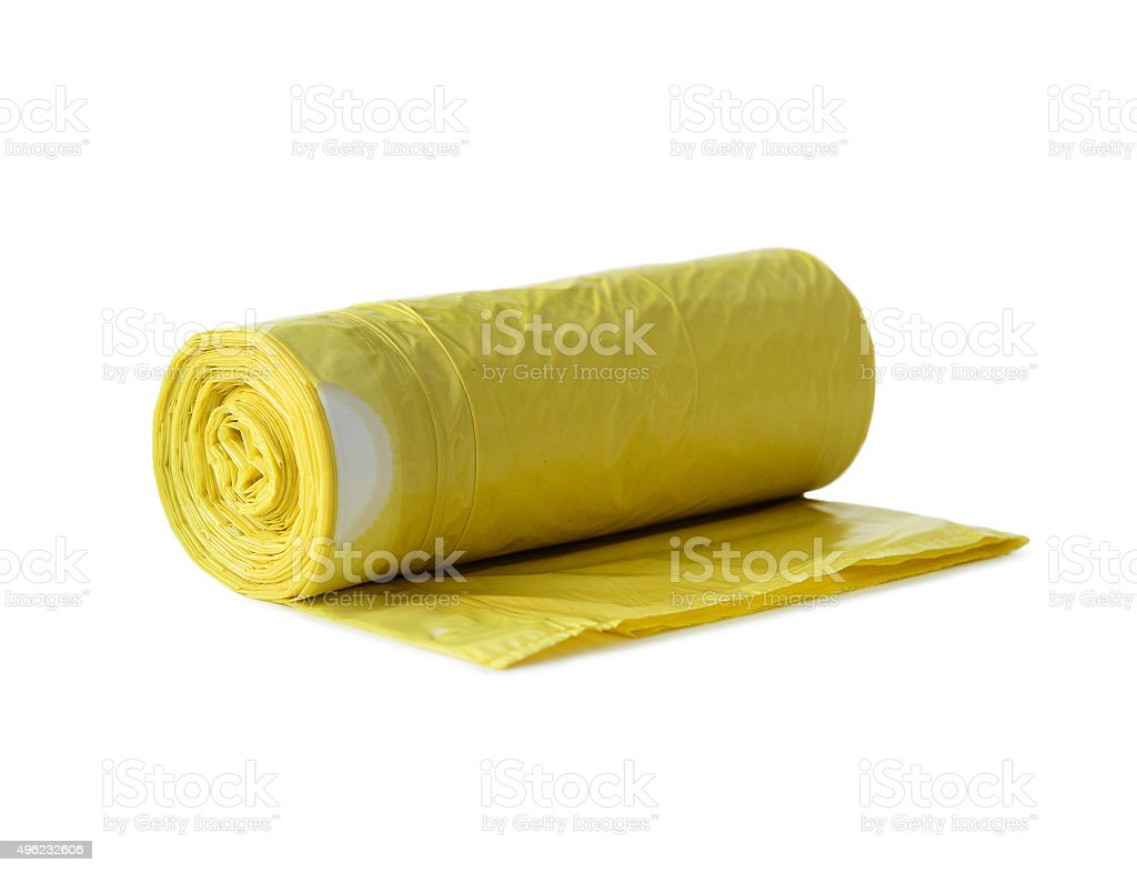 roll of yellow garbage bags stock photo