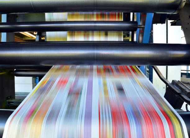 roll offset print machine in a large print shop for production of newspapers & magazines roll offset print machine in a large print shop for production of newspapers & magazines printing plant stock pictures, royalty-free photos & images