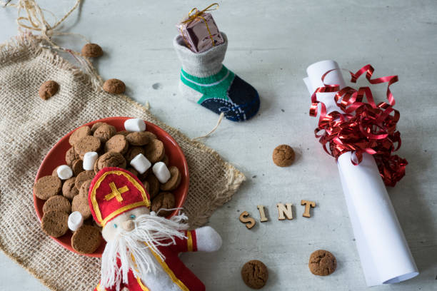 roll paper, sock and bowl with ginger nuts, kruidnoten, for Sinter event in The netherlands Sinterklaas event scene, with traditional candy. The Netherlands and Belgium sinterklaas stock pictures, royalty-free photos & images