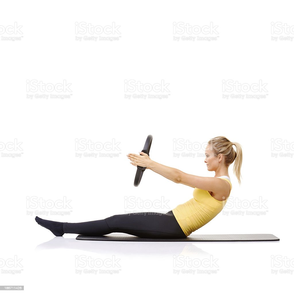 Roll up exercise with her pilates ring royalty-free stock photo