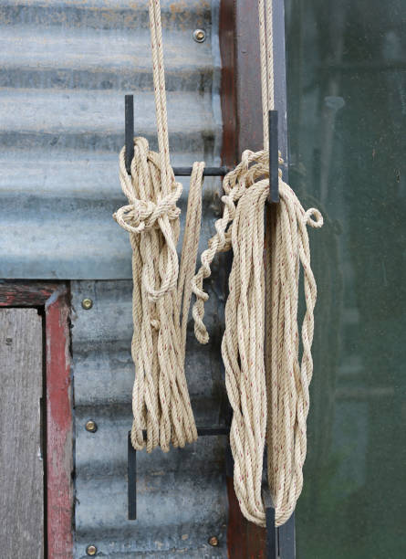 roll up nylon rope and knot against zinc wall. - musica industrial foto e immagini stock