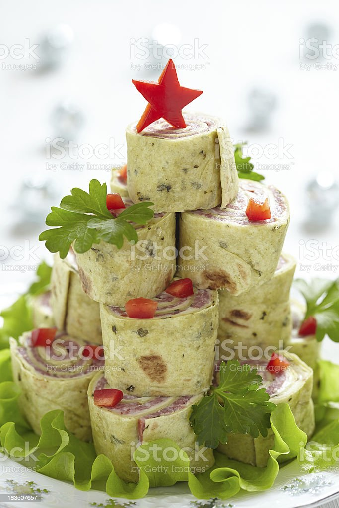 Roll up tortilla, ham and cheese for Christmas royalty-free stock photo