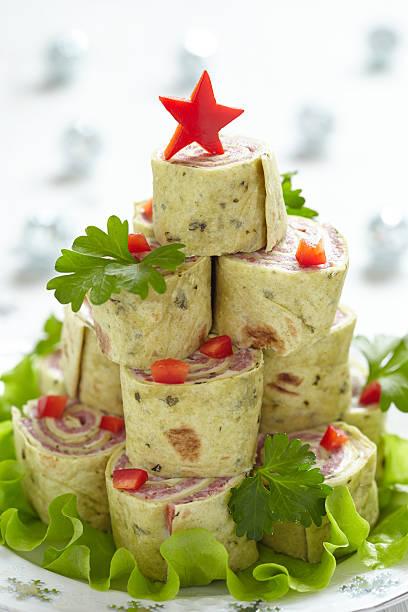 roll-up-tortilla, schinken und käse für weihnachten - käse wurst salat stock-fotos und bilder