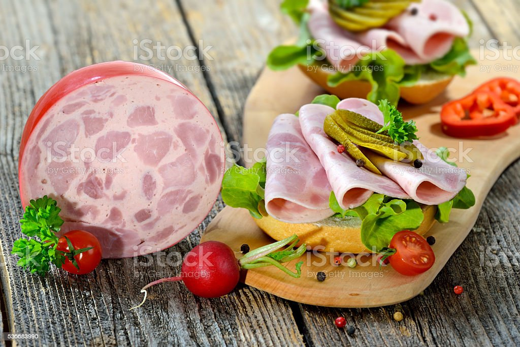 Roll with sliced sausage stock photo