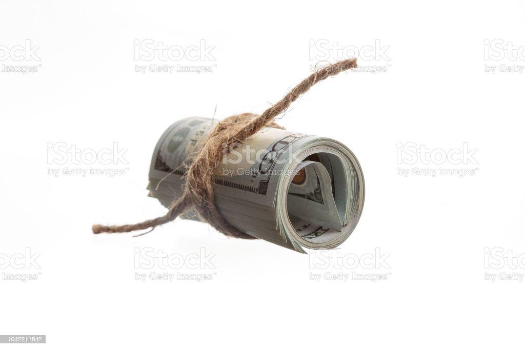 Laminado en billetes de dólares americanos sobre un fondo blanco - foto de stock