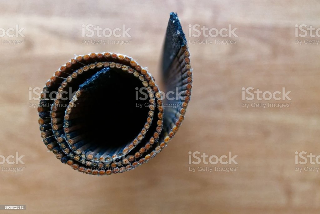 Rolled Bamboo litter on a wooden table texture stock photo
