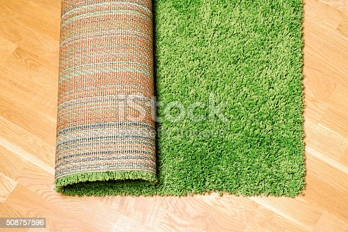 istock rolled carpet on the floor 508757596
