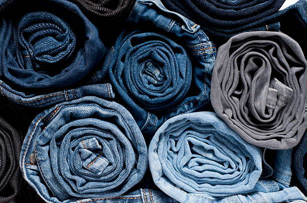 Rolled Denim Jeans stock photo
