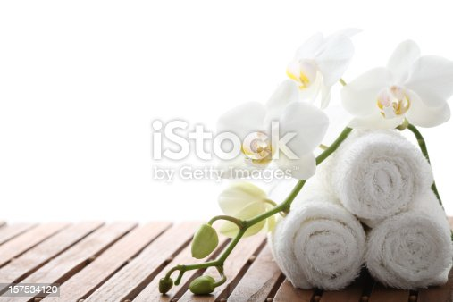 Spa concept with white orchid and towel