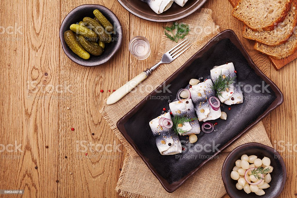 Rolled herring in vinegar, served with onions and pickles. royalty-free stock photo