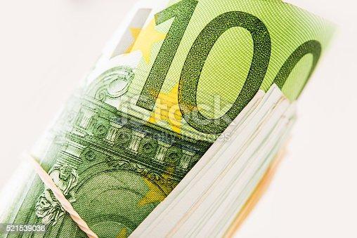 istock Rolled Hundred Euros Bills 521539036