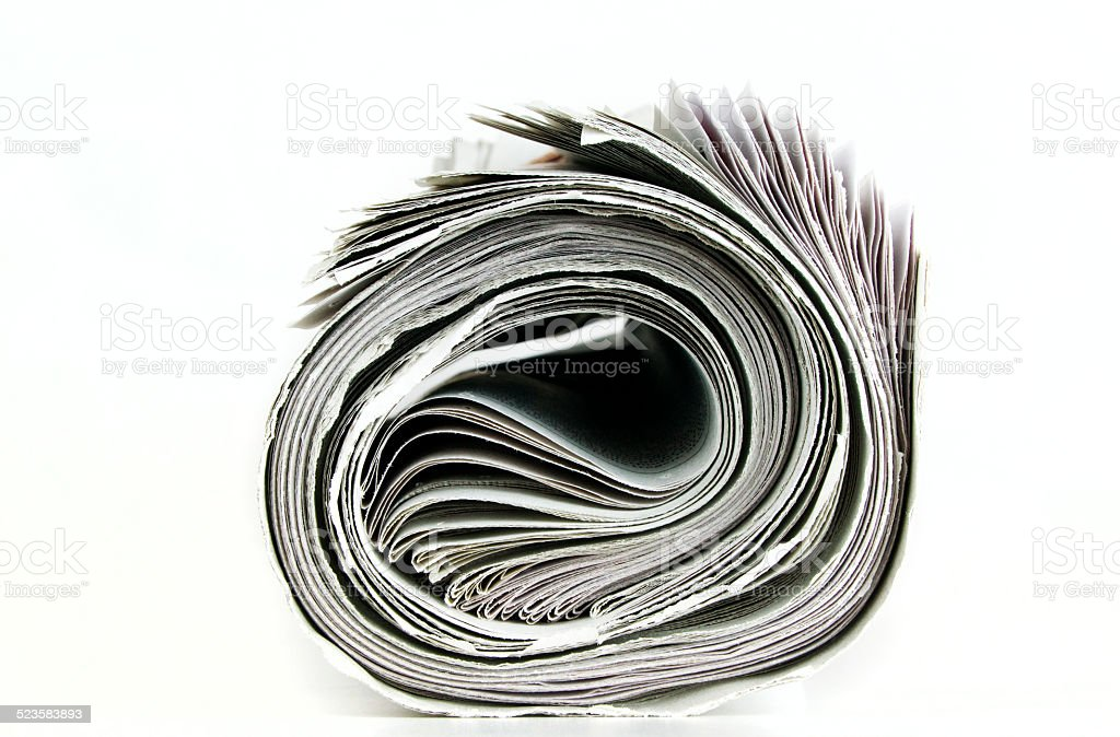 rolled newspaper isolated stock photo
