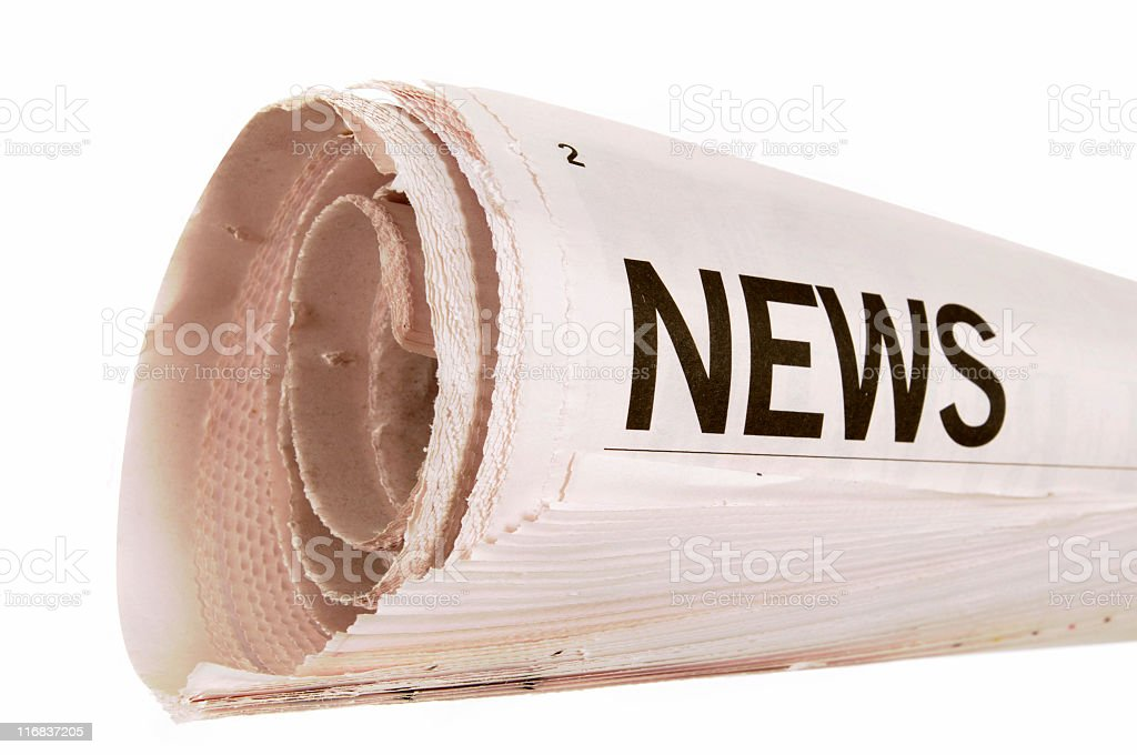 Rolled newspaper royalty-free stock photo