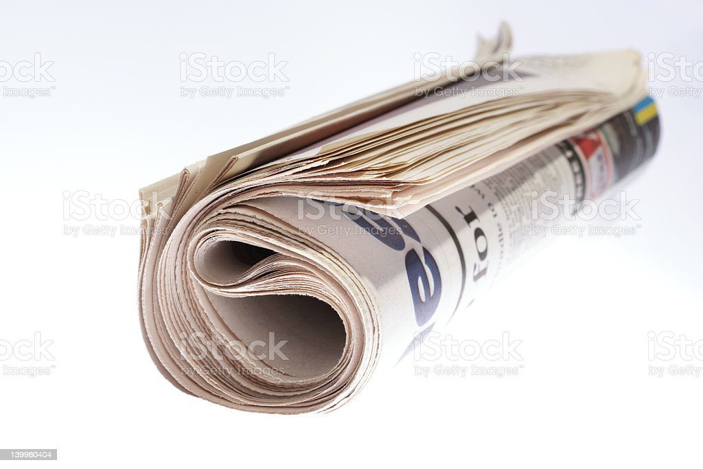 Rolled newspaper ready to go in the recycle bin royalty-free stock photo