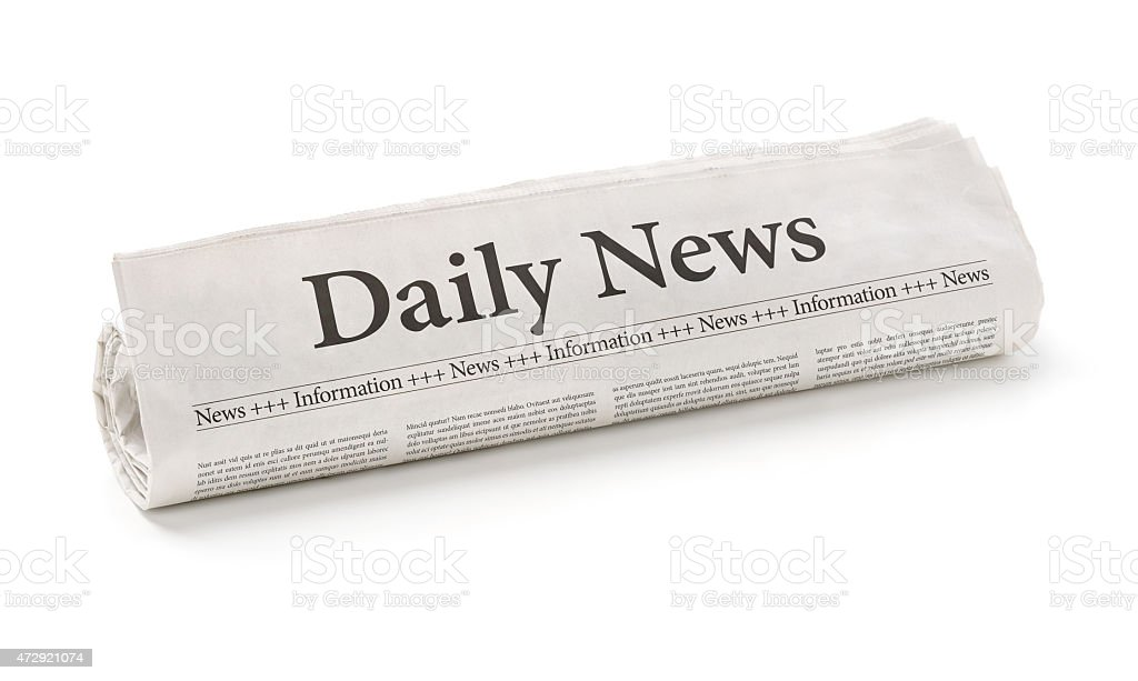 Rolled newspaper with the headline Daily News stock photo