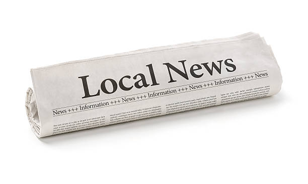 Rolled newspaper with the headline Local News stock photo