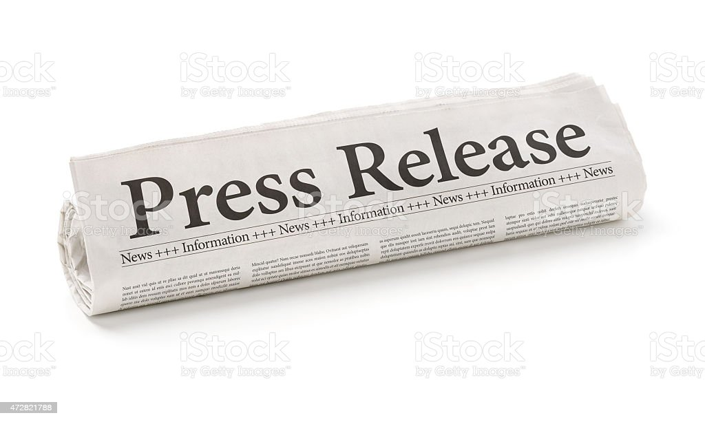 Rolled newspaper with the headline Press Release stock photo