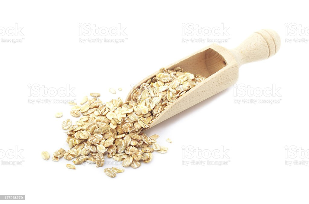 Rolled oatmeal in a scoop stock photo