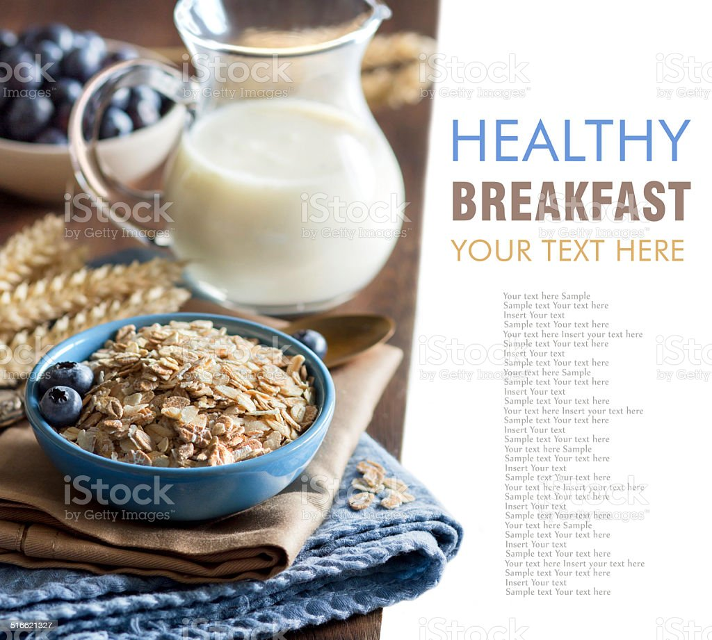 Rolled oats in a bowl with berries and milk stock photo