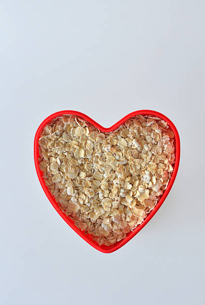 Rolled Oats in a Heart stock photo