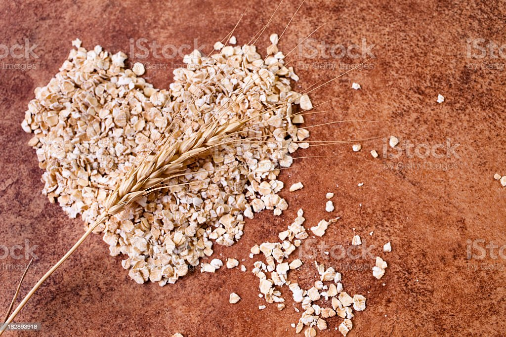 Rolled oats in shape of heart with stem wheat. royalty-free stock photo