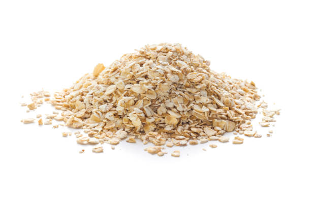 rolled oats on white - porridge foto e immagini stock