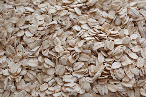 A close-up of organic rolled oats.