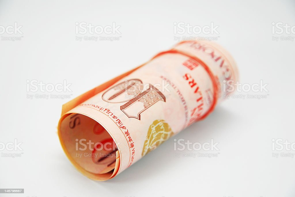 Rolled Singapore dollars on a white background stock photo