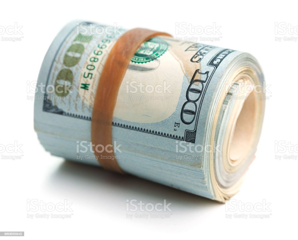 rolled stack of dollars stock photo
