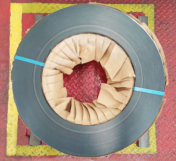 Rolled steel coil, Steel strapping, top view, factory warehouse in coil center stock photo