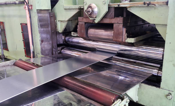 Rolled steel sheet coil slitting process in factory warehouse, coil center stock photo