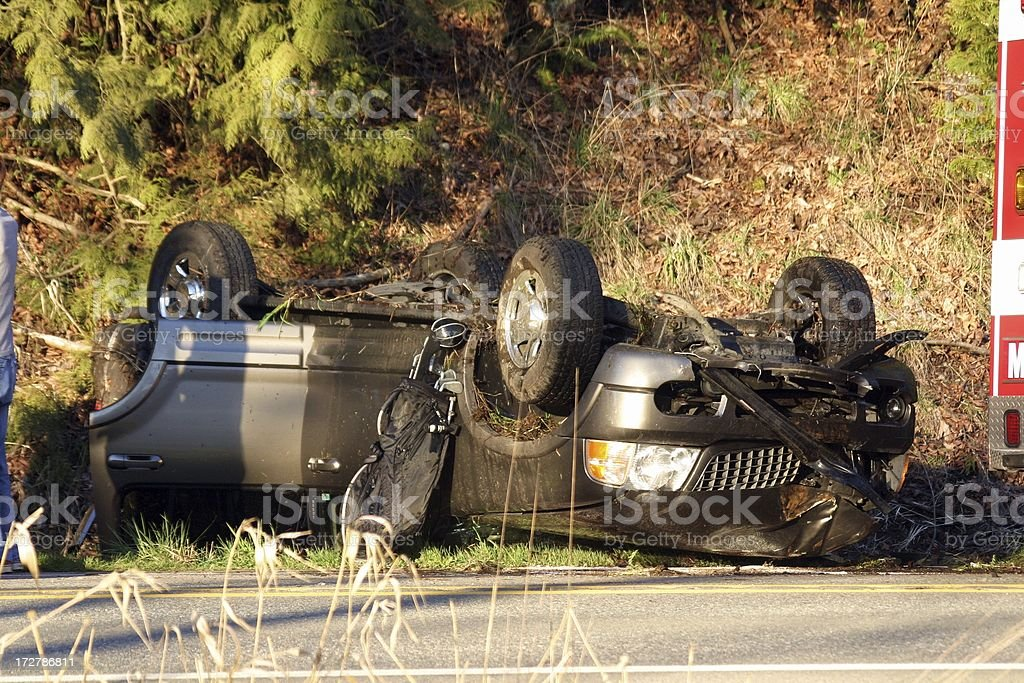 Rolled SUV and Golf Clubs royalty-free stock photo