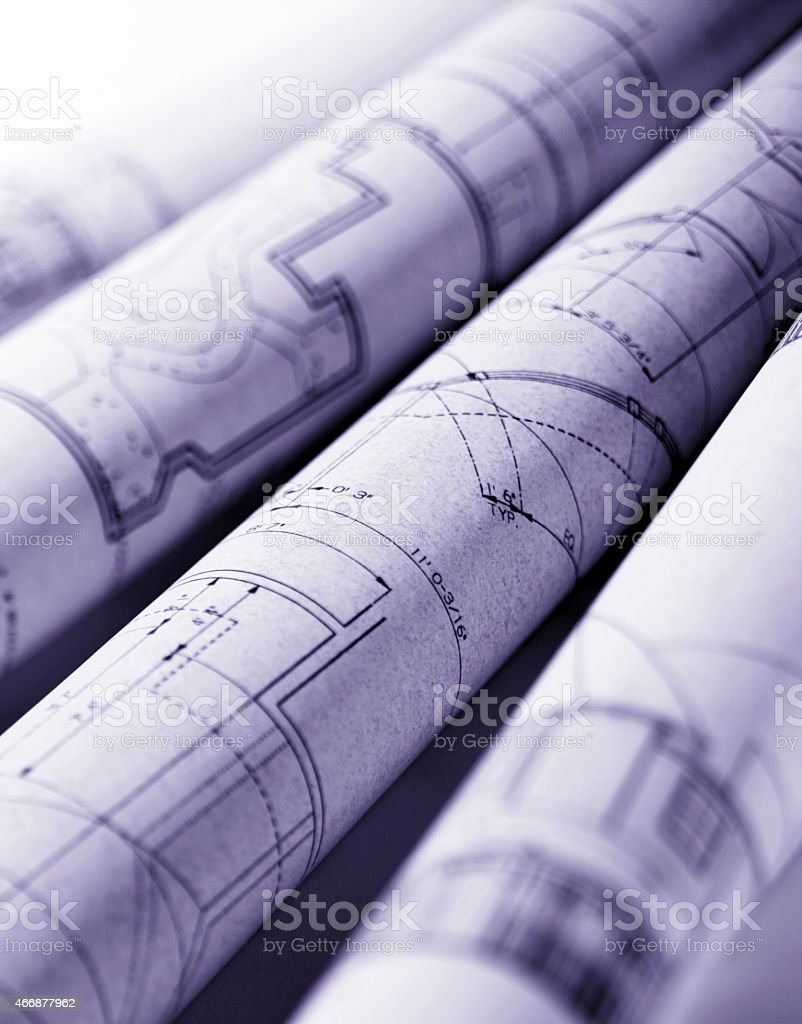 Rolled Up Blueprints stock photo