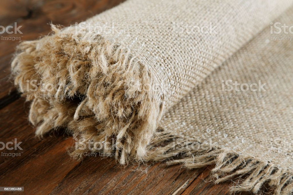 Rolled up burlap roll on an old table foto stock royalty-free